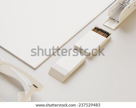 White box of matches and other branding on white paper background