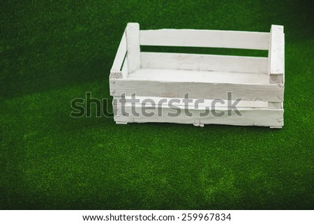 white box on a green background