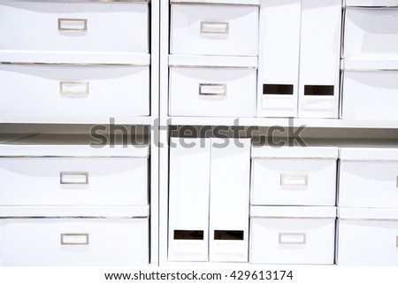 white boxes on shelves
