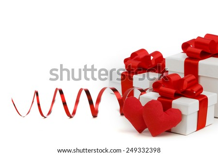 White boxes with red handmade hearts and decorative hearts isolated on white background - stock photo