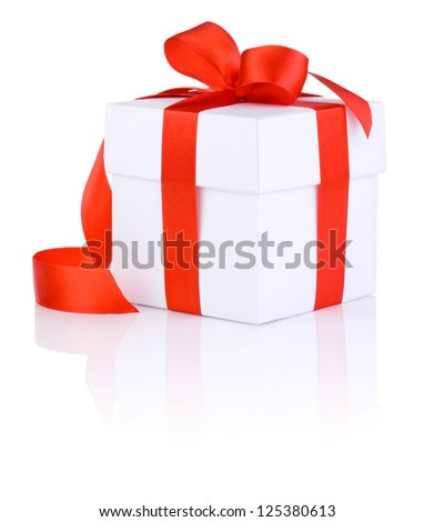White boxs tied with a red satin ribbon bow Isolated on white background