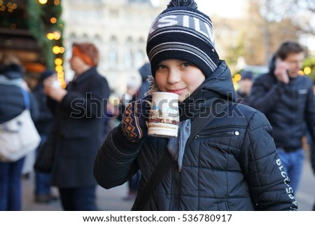 White boy drinking non-alcoholic punch at a Christmas Market in Vienna Austra - December 13, 2016