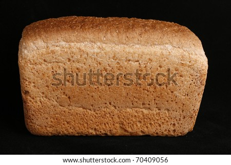 White bread on black background.