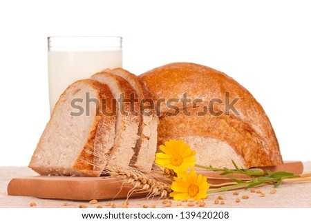 White bread slices with glass of milk over white background - stock photo
