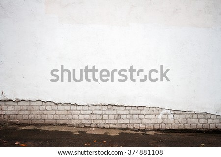 White brick and plastered wall background - stock photo