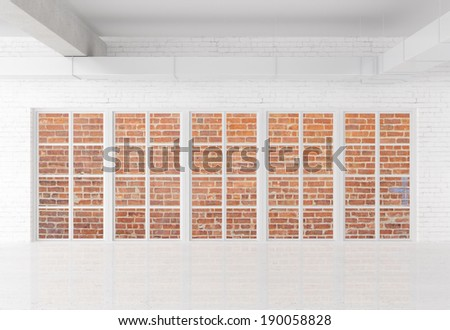 white brick loft with window - stock photo