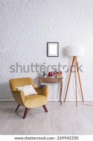 white brick wall and books - stock photo