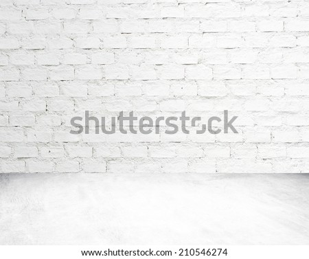 White brick wall and cement floor room in perspective. - stock photo