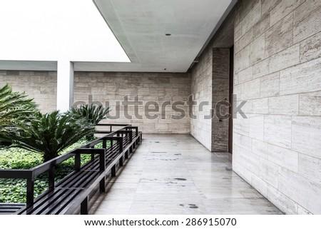 white brick wall and empty sandstone road - stock photo