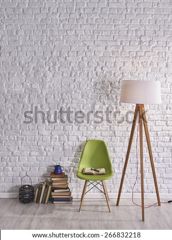 white brick wall, books and lamp - stock photo