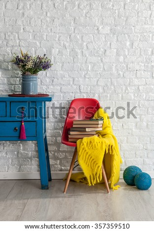 white brick wall decor and red chair  - stock photo