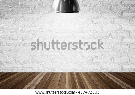 White brick wall illuminated by the ceiling lamp with copy space.