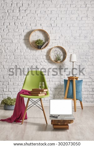 white brick wall interior style, laptop, green chair  - stock photo