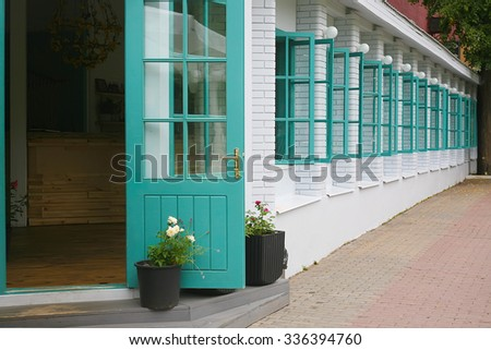 white brick wall with open windows - stock photo