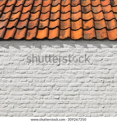 White brick wall with orange roof tiles for background - stock photo