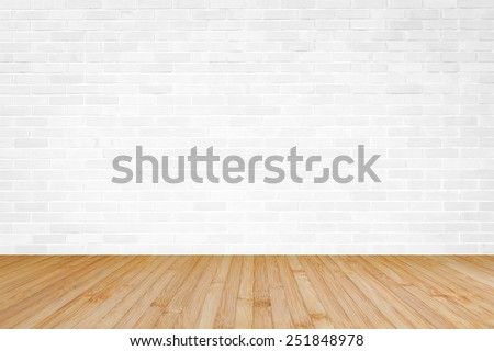white brick wall with wooden floor background - stock photo