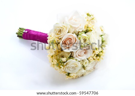 white bridal boquet with magenda ribbon - stock photo