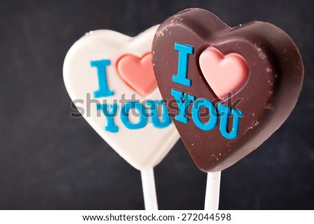 "White & Brown chocolate hearts with ""I love you"" colorful inscription. - stock photo"