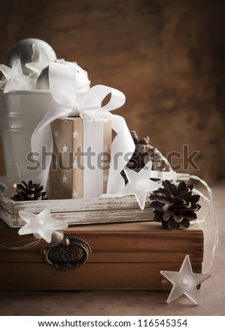 White Brown Christmas Gifts with a Box in the Middle with White Ribbon and Pine Cones - stock photo