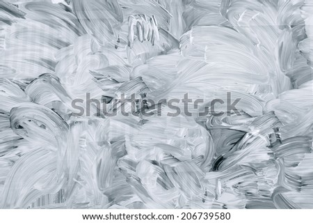 White brush marks on the glass. - stock photo