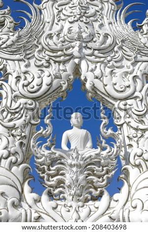 White Buddha Background sky Rongkun Temple Thailand - stock photo