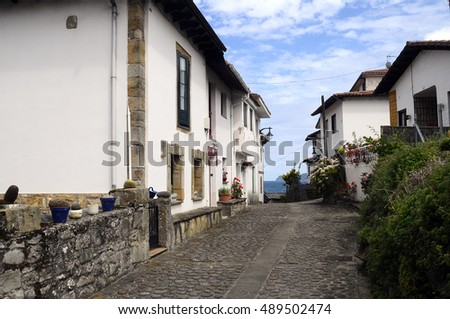 White buildings and home in Tazones fish village in Spain