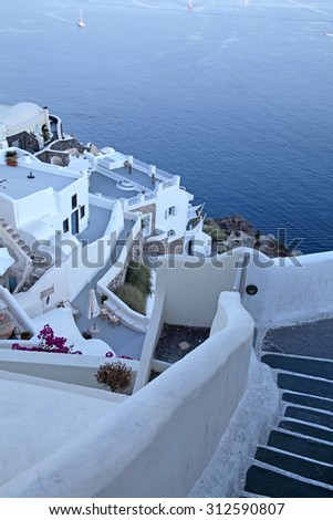 white buildings of Oia village and Aegean sea at sunset, Santorini island, Greece