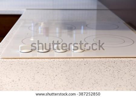 White built-in stove in modern kitchen - stock photo