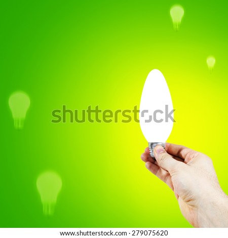 White bulb in a man's hand - stock photo
