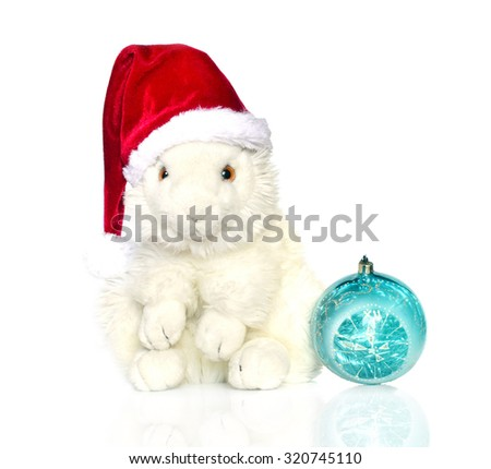 White bunny in Santa hat and ball. Merry Christmas.