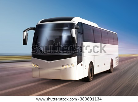 white bus moves on divided highway - stock photo