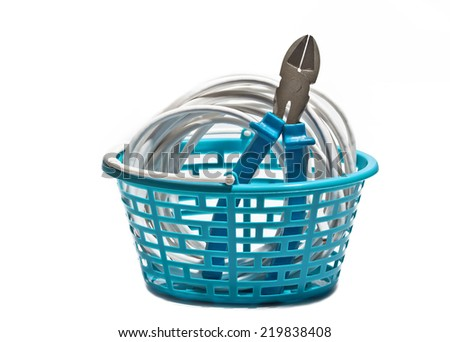 White cable with wire cutters in your shopping cart - stock photo