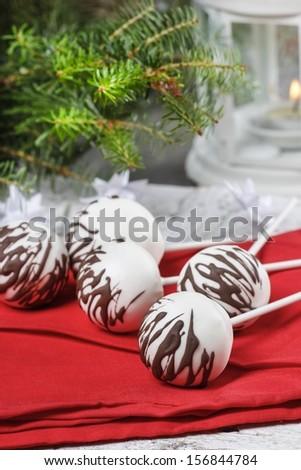 White cake pops decorated with dark chocolate - stock photo