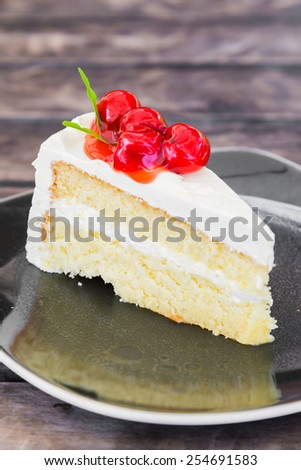 White cakes with cherry on top