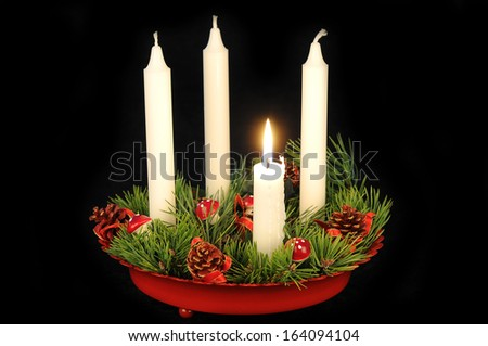 White candles in a red advent candle holder - stock photo