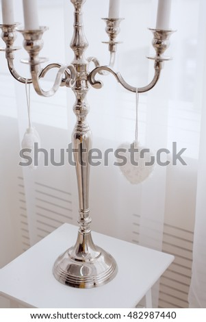 white candles on candlestick in a room