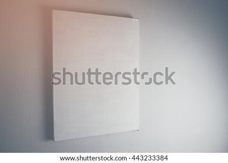 White canvas frame on white background. - stock photo