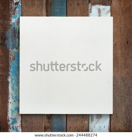 White canvas frame on wooden wall background. - stock photo