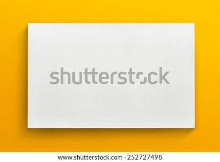 White canvas frame on yellow background. - stock photo