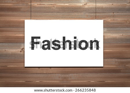 white canvas hanging in front of wooden wall fashion