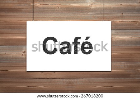 white canvas hanging on wooden wall cafe - stock photo
