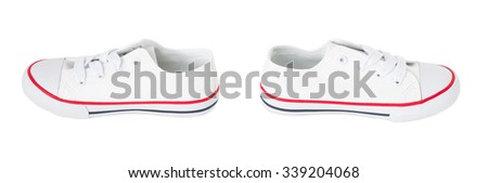 White canvas shoes with red strip. Isolated on a white background.