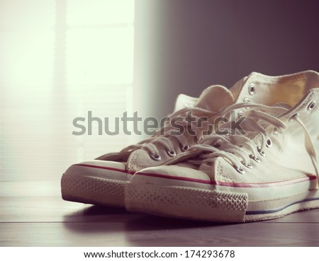 White canvas shoes, youth culture and style. - stock photo