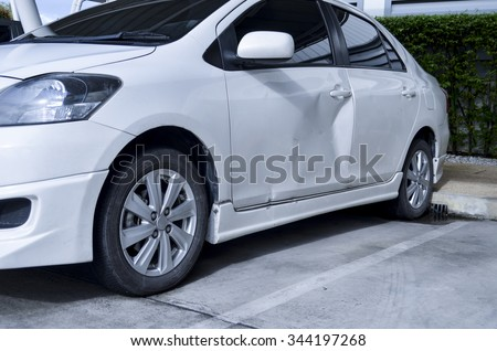 White Car Body Get Damage on the door.With Color Filter, Selective Focus,Car door dent - stock photo