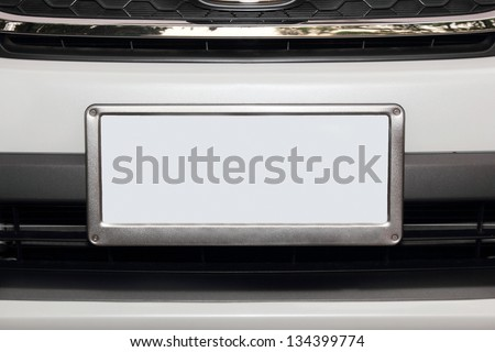 white car from front view  with empty white number plate - stock photo