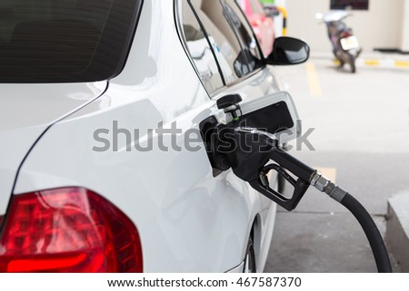 White car refueling on a gas station