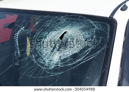 White car with broken front windshield - stock photo