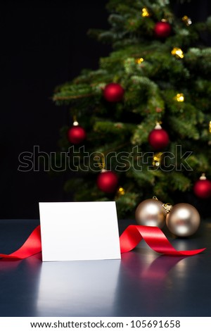 White card in elegant Christmas decoration. The card can be used for personal Holiday or Christmas greetings. - stock photo
