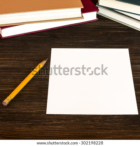 White card, pencil and books on the table./ White card, pencil and books on the table. - stock photo