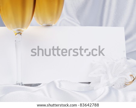 White card, wedding boutonniere on a background from  satin